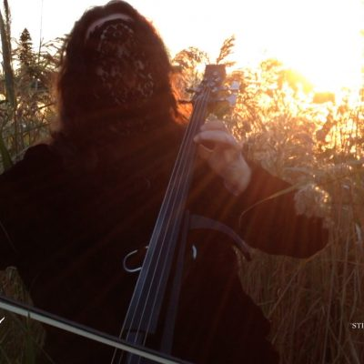 Laceface plays her cello as the sun sets on another day...or is it rising?